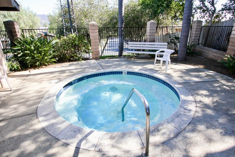 Hot tub surrounded by iron fence at Nob Hill in Vista California