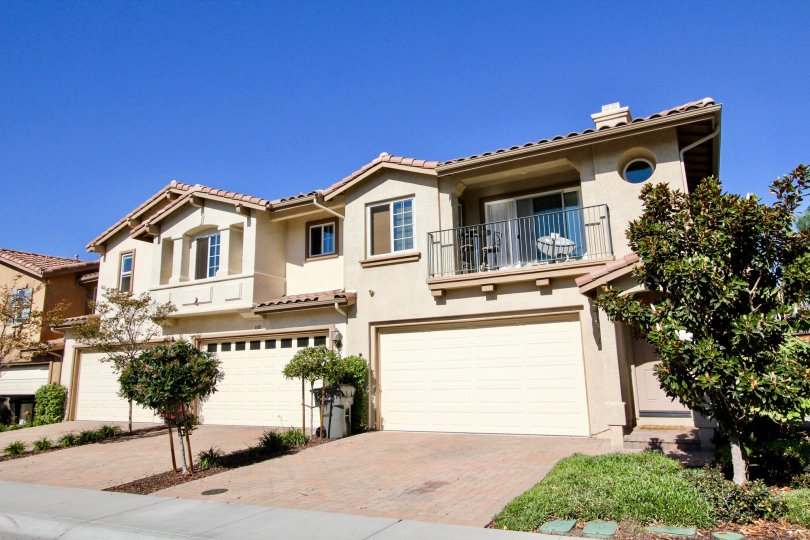 Brick drive and garage at the residential Oak Drive Villas located in Vista, CA