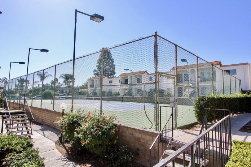 Lawn Tennis court with fence and focus lights in Vista Hills Estates.