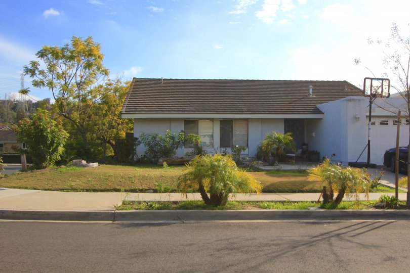 Front exterior view of single st ory home in Capistrano Highlands Laguna Hills