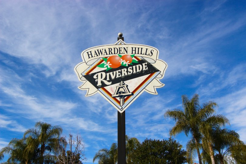 A sign letting residents of Hawarden Hills know they are homw