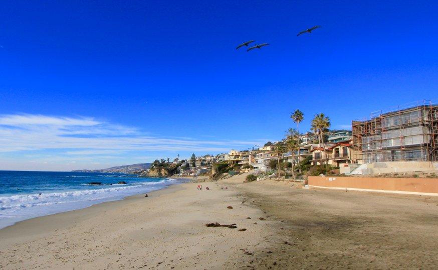 Sandy beach backing up to properties in Lagunita Laguna Beach
