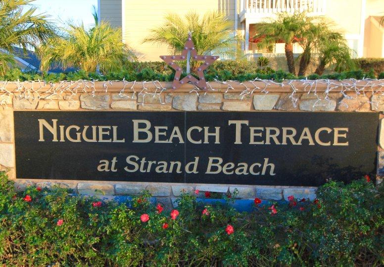 Niguel Beach Terrace at Strand Beach Sign