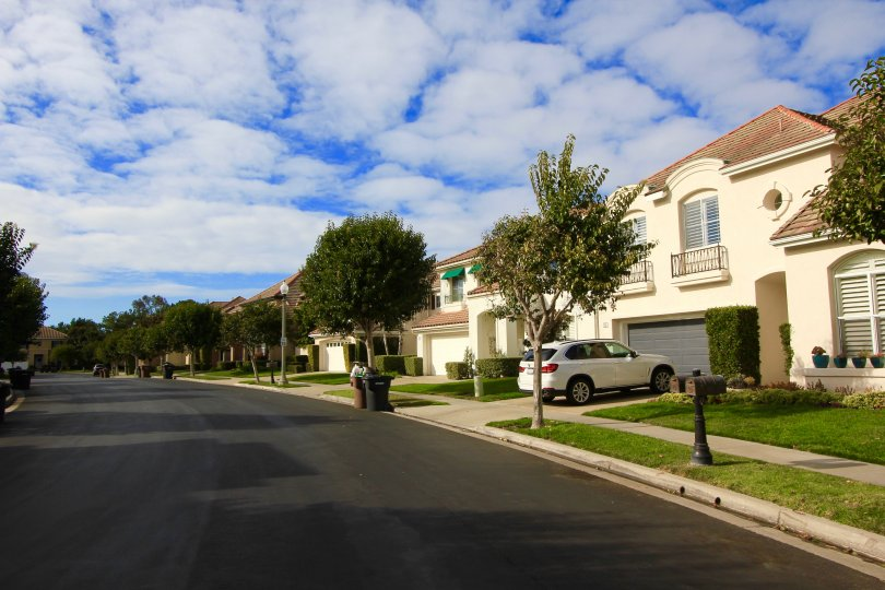 View of street and front exteriors of homes in Saint Michel Newport Coast CA