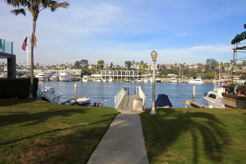park and walkway to dock and water in Sea Island, Newport Beach CA