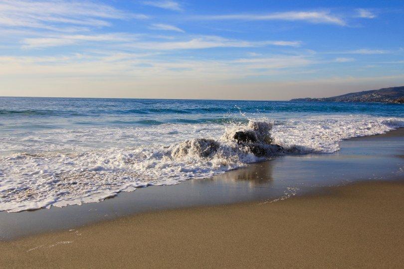 Wave crashing on beach in Upper Diamond Laguna Beach CA