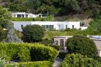 Several single level mid century modern homes at Trousdale Estates