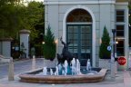 A statue of two deer in a fountain greet residents at the entry of The Oaks