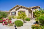 Beautiful desert landscaped front yard on this Campanile home