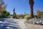 A home sits at the back of a large lot in Cathedral City Cove
