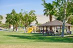 A large park with covered picnic area and playground at Century Park