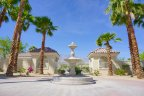 A large fountain sits in a brick laid courtyard at Cimarron Cove