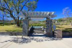 The path that park enthusiasts from East Hill can take to the basketball courts is marked by a lovely sign and pergola