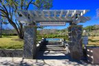 The path that park enthusiasts from Terraces take to the basketball courts is marked by a lovely sign and pergola