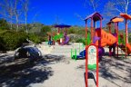 The colorful playground at the Coto Sports Park is specially designed for Village children 2 to 5 years old