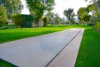 Play shuffleboard with friends and family at the community of La Rocca