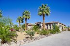 This single level home sits far back from the street in Desert River Estates