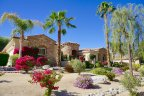 This single story home with stone accents is located in Desert River Estates