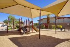 A covered play area beside the playground at Shadow Hills in Indio Ca
