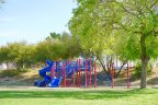 Bring your children to play on the playground at Villa Montego in Indio Ca