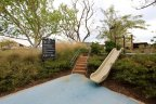 An elevated slide opens to a soft blue surface at Great Park