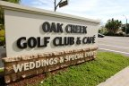 The sign for Oak Creek Golf Club & Café in Irvine