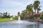 A fountain bubbles in a pond at Haciendas at La Quinta