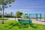 The Box Springs Playground in Moreno Valley with jungle gym and swings