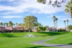 Fairway view with water feature and fountain in Oasis Country Club