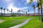 Lush green landscape surrounds the golf cart path at Sun Terrace