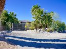 The gated home in Chino Canyon offers additional privacy