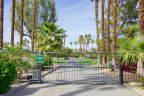 A gate within Tamarisk Country Club looking out an unrestricted area