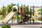 Bring your children to play on the playground at Tuscany in Rancho Mirage