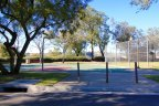 A well maintained basketball court at Oak Tree Park next to Las Flores