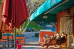 Residents sit at a picnic table drinking coffee at Laurel Canyon Deli