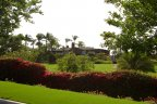 A view from the street of the Hialeah Home with multiple acres of manicured lawn.