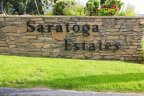 A Saratoga Estates sign at the entrance of private gated community in Bonsall California.