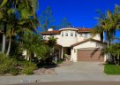Beautiful Home with Palms tree on its yard is part of La Costa Valley Home