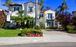 This Mediterranean inspired single family home with beautiful front yard resides in Mar Fiore community