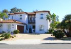 This beautiful white Mediterranean style home with two car garage is located in Mar Fiore Neighborhood