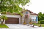 This glorious home with modest lawn and interesting landscape design is located in Otay Ranch Neighborhood