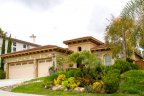 Stunning single family home with beautiful landscape on its front lawn is proud resident of family friendly Rolling Hills Ranch Neighborhood in Chula Vista California