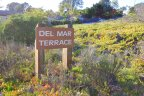 A sign at the entrance of Del Mar Terrace