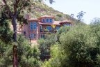 Luxury Home in Harbison Canyon with large windows offer natural light and fair panoramic views of the valley