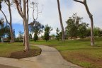 Walking trail passing through the lush green lawns of Fieldstone Neighborhood