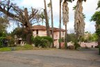 This Pink home with spacious rooms and fair views is located in Lake Hodges California