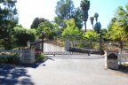 An entrance to gated home with beautiful landscape in Morro Hills Neighborhood