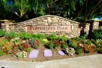 A sign of Peppertree Park with florals