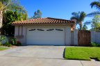 This cozy home with wooden gate is located in Murray Mission Community in Oceanside California