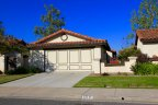 This gorgeous single family home with beautiful lawn resides in Murray Mission Neighborhood